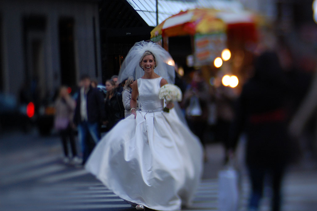Woman in a wedding dress crossing 5th Avenue